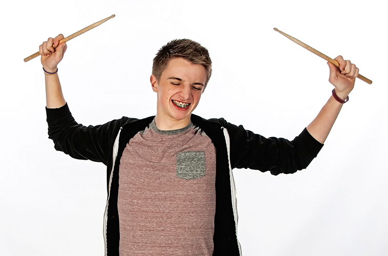 photo of high school senior with his drumsticks